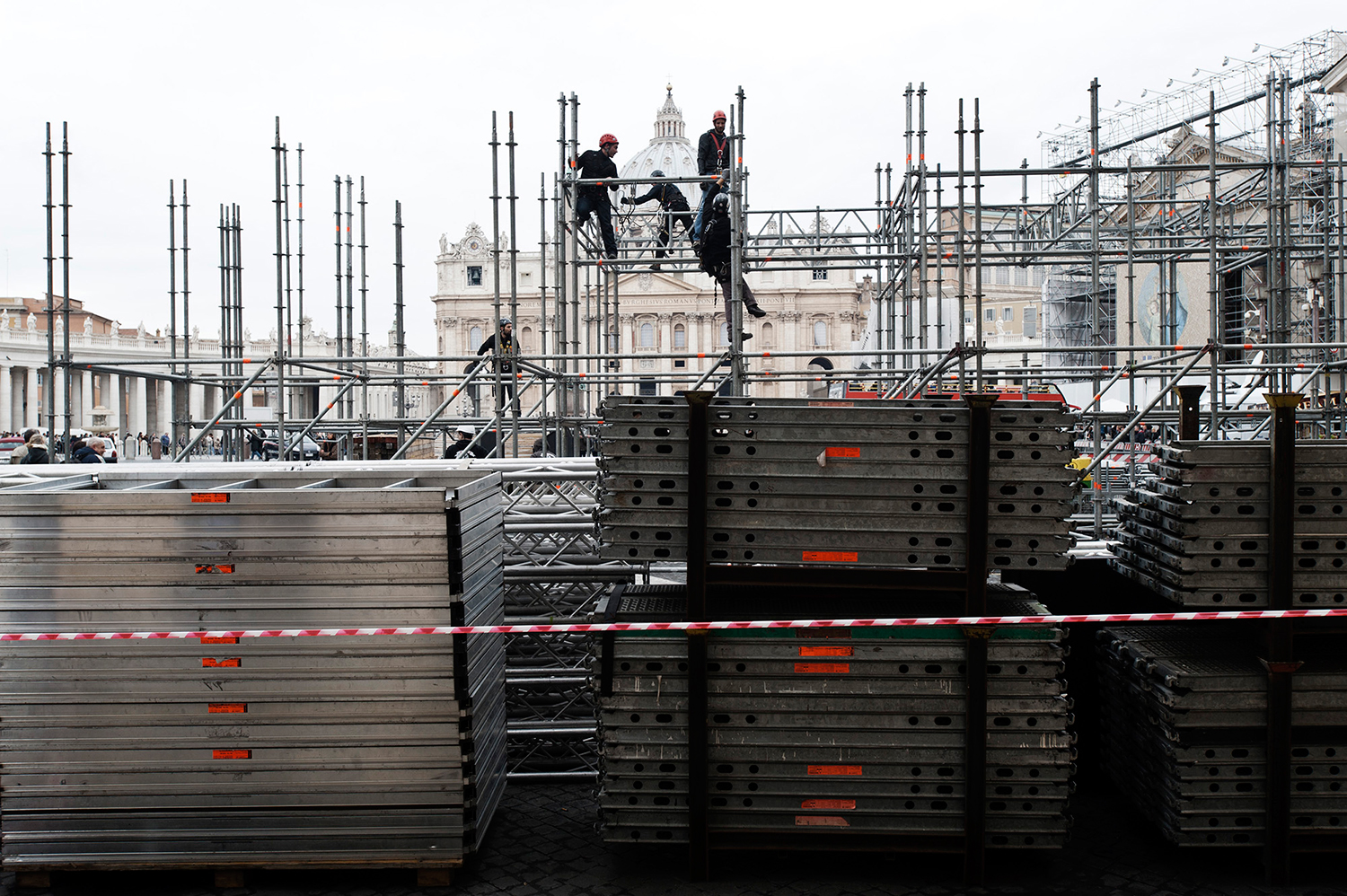 Construction of the scaffolding for the TV and Radio crews on piazza Pio XII just across the road of St Peter's Square.