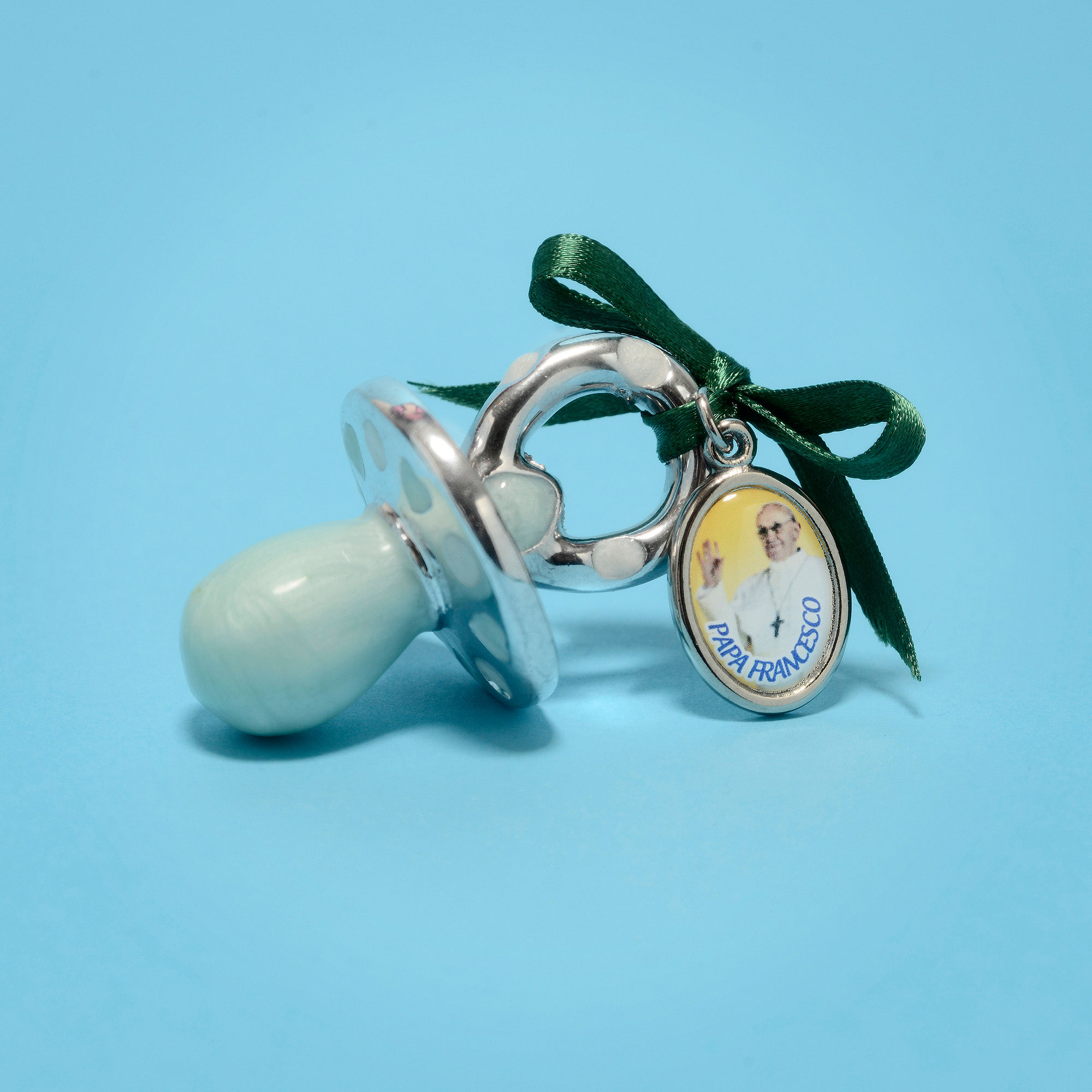 Ceramic pacifier with Pope Francis's small medal.