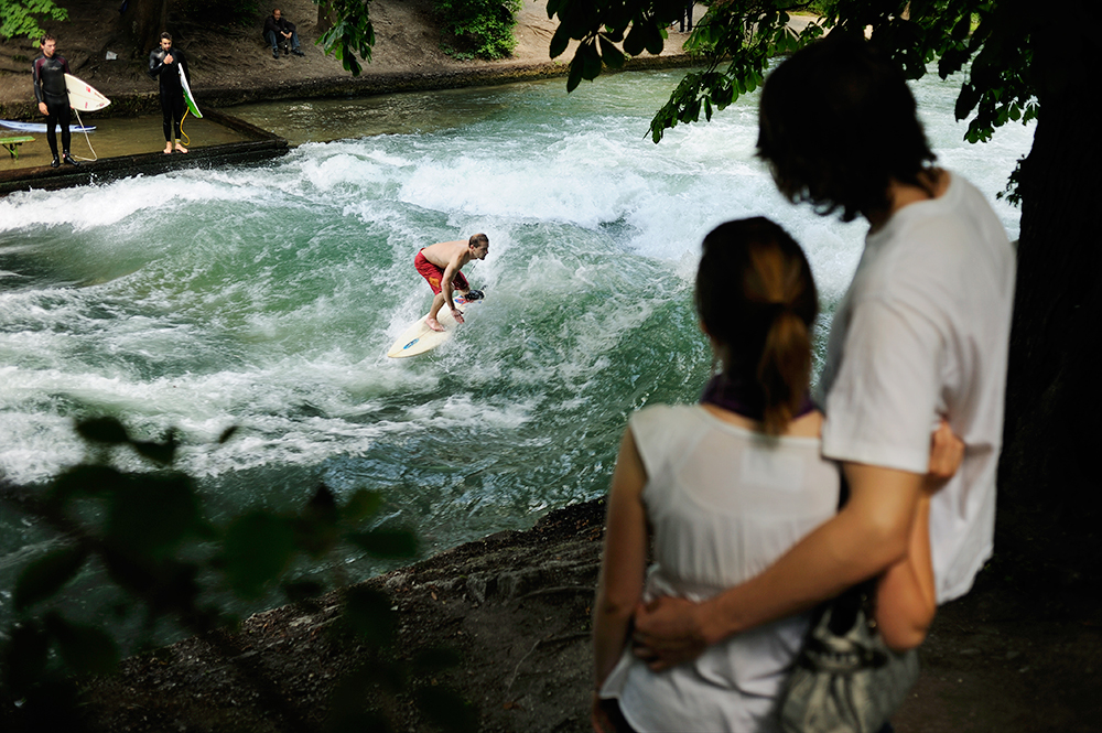 Since the seventies when river surfing was invented in Munich surfers ride the Eisbach static wave.