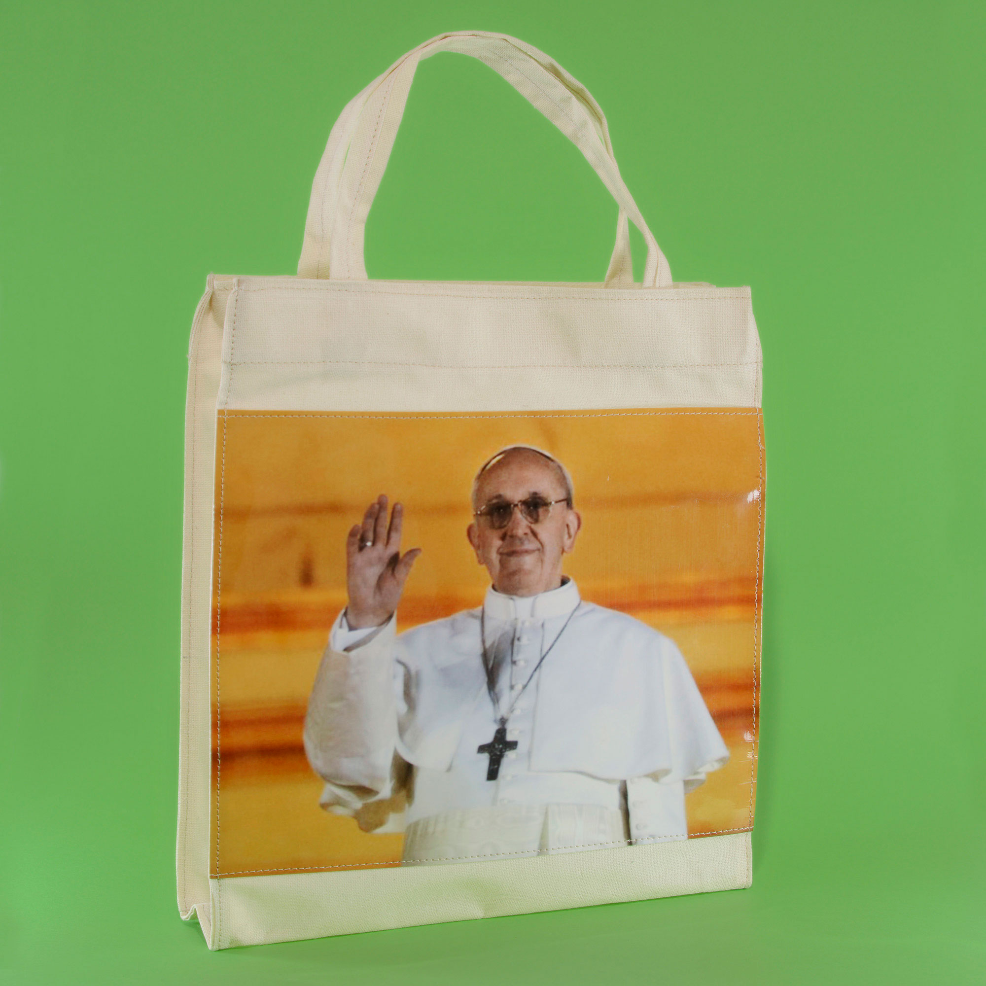 Tote bag with plastic photograph of Pope Francis.