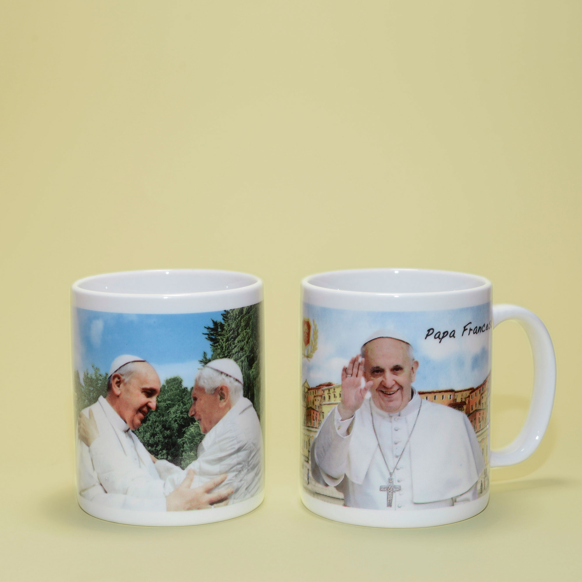 Mug with photograph of Pope Francis and Pope Emeritus Benedict XVI encounter and Pope Francis's mug.